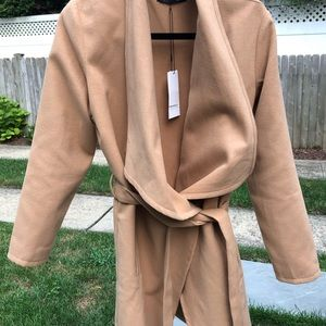 Long belted tan coat. Shawl color.